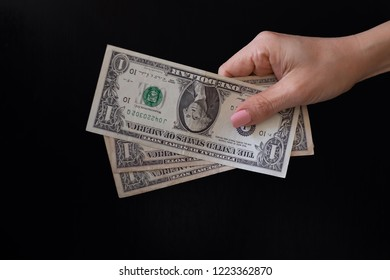 Chiang mai, Thailand - September 15,2018: Dollars in hand on a black background