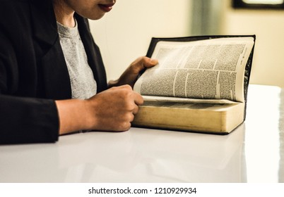 """Chiang Mai, Thailand - September 15th, 2018 Women read the Bible on the table To remember the Holy Spirit In the """"Sukkasem"""" Church"""