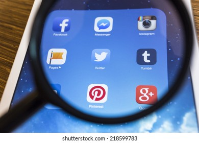 CHIANG MAI, THAILAND - SEPTEMBER 17, 2014: All of popular social media icons on tablet device screen with magnify glass.