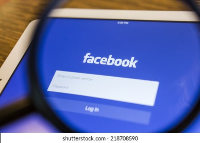 CHIANG MAI, THAILAND - SEPTEMBER 17, 2014: Facebook application sign in page on Apple iPad Air. Facebook is largest and most popular social networking site in the world.