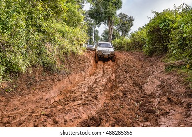 CHIANG MAI, THAILAND - SEPTEMBER 17: Undefined Driver on Toyota LN106 off-road car on muddy road in the countryside, September 17, 2016 in Chiang mai, Thailand.