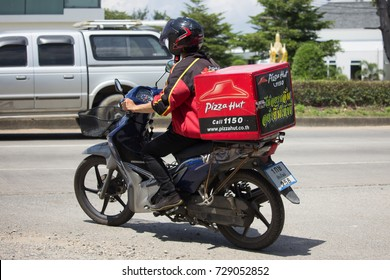 CHIANG MAI, THAILAND -SEPTEMBER 23 2017:  Delivery service man ride a Motercycle of Pizza Hut Company. On road no.1001, 8 km from Chiangmai city.
