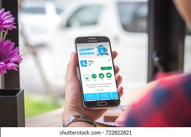 Chiang Mai, Thailand - September 27, 2017: Samsung Galaxy S6 smartphone launches alipay application on the desk screen at the coffee shop.