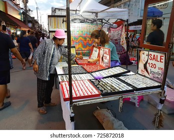 CHIANG MAI, THAILAND - SEPTEMBER 29 : Unidentified asian woman buying lotery at street market in the evening on September 29, 2017 in Chiang Mai, Thailand.