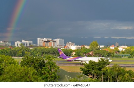 Chiang Mai, THAILAND - September 4, 2016 ; Airplane of Thai Airways taking off on runways at Chiang Mai International Airport, After it stops raining, maybe we can see the rainbow on background.