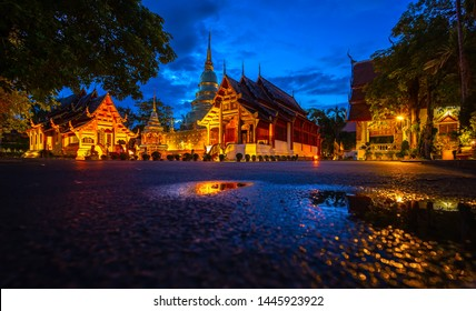 Chiang Mai, Thailand. Wat Phra Singh Temple in twilight time and reflection.