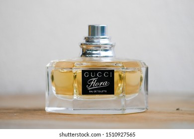 Chiang mai, Thailand-August 24, 2019.A clear glass spray bottle of Flora by Gucci Eau de toilet for women on the wood table.