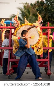 CHIANG MAI, THAILAND-JANUARY 18 : 30th anniversary Bosang umbrella festival,boy in traditional costume show the drum annual festival at San Kamphaeng. on Jan.18, 2013 in Chiang Mai, Thailand.