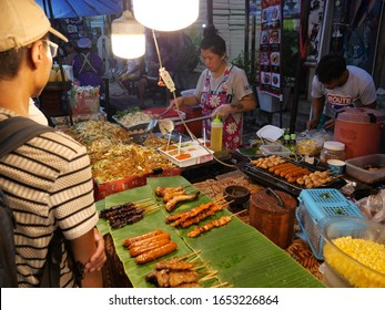 Chiang Mai, Thailand-October 6, 2019: food stall in Chiang Mai Night bazaar/ Weekend Walking Street in Chiang Mai, Thailand. Locals and tourists buying the food from the vendor