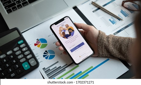 CHIANG MAI,THAILAND - APR 11, 2020 : A working from home employee is downloading the Microsoft Teams social platform, ready for remote working in isolation from home