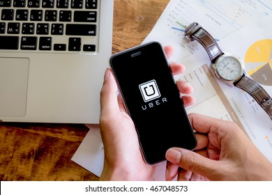CHIANG MAI,THAILAND - AUG 2,2016 : A woman hand holding Uber app showing on Samsung note 3,Uber is smartphone app-based transportation network.