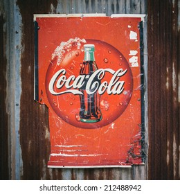 CHIANG MAI,THAILAND - AUG 23 : Old rust condition vintage wall of Coca Cola logo. on August 23, 2014 in Chiang Mai Thailand.