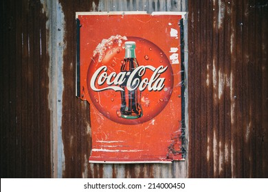CHIANG MAI,THAILAND -AUG 23: Old rust condition vintage of Coca Cola logo. on August 23, 2014 in Chiang Mai Thailand.