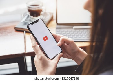 CHIANG MAI,THAILAND - Feb 16, 2019: A woman showing screen shot of Youtube on iphone x,  YouTube app on the screen, YouTube is the popular online video sharing website. - Image