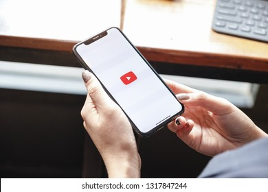 CHIANG MAI,THAILAND - Feb 16, 2019: A woman showing screen shot of Youtube on iphone x,  YouTube app on the screen, YouTube is the popular online video sharing website.