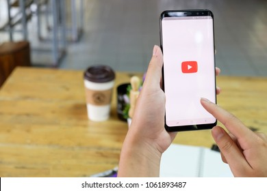 CHIANG MAI,THAILAND - FEB 19, 2018 : Samsung galaxy S8 Plus on woman hands open Youtube application,Youtube is the popular video-sharing website that founded.