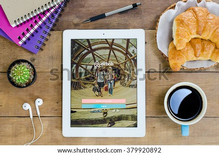 CHIANG MAI,THAILAND - FEB 22,2016 : IPad 4 open Airbnb application. Airbnb is a website for people to list, find, and rent lodging.