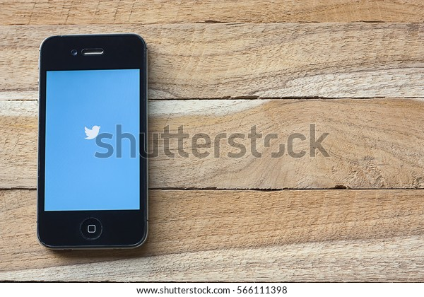 CHIANG MAI,THAILAND - Jan 28, 2017 : Apple iPhone 4s smartphone with Twitter app on screen, topview.