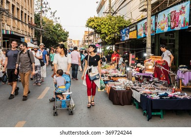 CHIANG MAI,THAILAND - JANUARY 30 : People walk among stalls at famous Saturday walking street market Wualai on January 30, 2016 in Chiang Mai, Thailand. Market is open Saturday from 4pm to midnight.