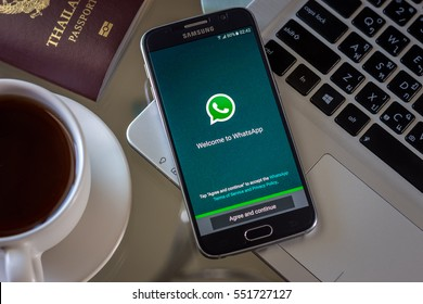 Chiang Mai,Thailand - January 9, 2017: Smartphone Samsung Galaxy S6 open apps whatsapp application on the screen on the desk.