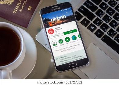 Chiang Mai,Thailand - January 9, 2017: Smartphone Samsung Galaxy S6 open apps airbnb application on the screen on the desk.