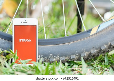 CHIANG MAI,THAILAND - JULY 6,2017:A white smartphone with logo of Strava application.Strava is the most popular for people who love social fitness application.