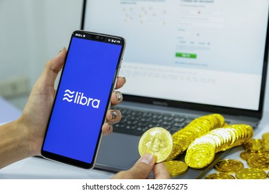 CHIANG MAI,THAILAND - JUNE 20,2019: Libra Facebook cryptocurrency and bitcoin cryptocurrency, Libra coins concept.