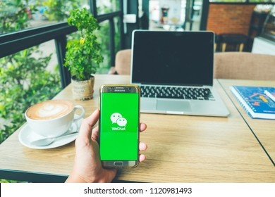 CHIANG MAI,THAILAND - June 26,2018:A Man holds Samsung Galaxy S7 edge Mobile Phone with WeChat app on the screen.WeChat is a Chinese multi-purpose messaging, social media and mobile payment app