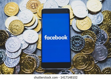 CHIANG MAI,THAILAND - JUNE 6,2019: Facebook app and bitcoin cryptocurrency fb coins concept.