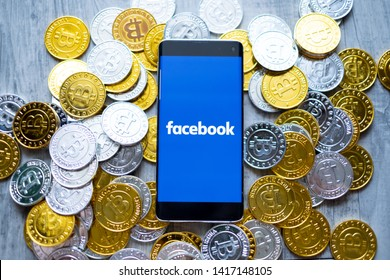 CHIANG MAI,THAILAND - JUNE 6,2019: Facebook app and bitcoin cryptocurrency fb coins or facebook ico concept.