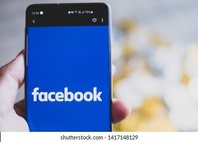 CHIANG MAI,THAILAND - JUNE 6,2019: Facebook coin facebook app and golden bitcoin coins or fb coins new cryptocurrency.