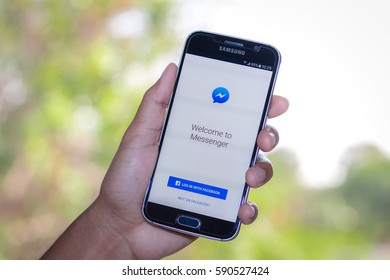 Chiang Mai,Thailand - March 1, 2017: Smartphone Samsung Galaxy S6 open apps facebook messenger application on the screen on the desk.