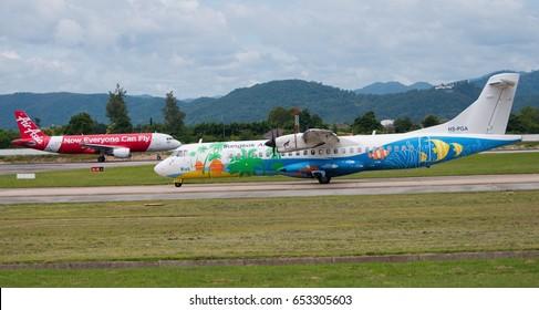 Chiang Mai,THAILAND - May 30, 2016 ; ATR72-500 of Bangkok Airways Reg. HS-PGA and Airbus A320-216 of Thai AirAsia Reg. HS-BBT on runway at Chiang Mai International Airport with mountains on background