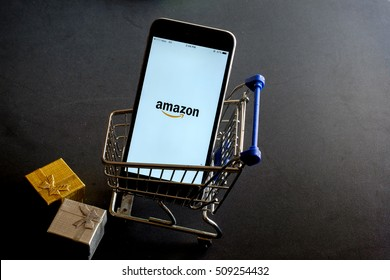 CHIANG MAI,THAILAND - NOV 03, 2016 : iPhone 6 Plus showing Amazon  apps. Amazon.com, Inc. is an American international electronic commerce company. It is the world's largest online retailer. Site