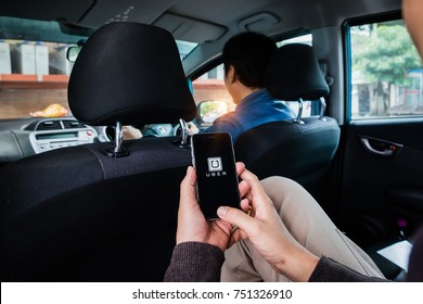 CHIANG MAI,THAILAND - NOV 09, 2017 : A man hand holding Uber app showing on iPhone 6s at destination, Uber is smartphone app-based transportation network.