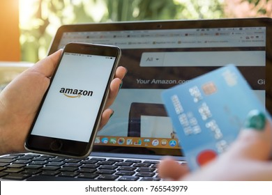 CHIANG MAI,THAILAND - NOV 30, 2017 : iPhone 6s showing Amazon logo and credit card shopping online. Amazon.com, Inc. American international electronic commerce company.