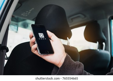 CHIANG MAI,THAILAND - NOV 30, 2017 : A man hand holding Uber app showing on iPhone 6s at destination, Uber is smartphone app-based transportation network.