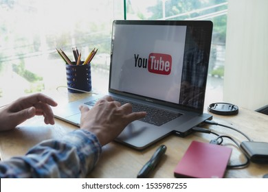 CHIANG MAI,THAILAND - Oct 15, 2019 : Creative producer planning about his upload video to youtube and Editing vlog of his on macbook pro for create youtube channel of business.