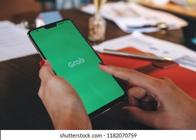 CHIANG MAI,THAILAND - Sep 09, 2018 : Oneplus6 digital mobile phone open grab application on woman hands,Grab taxi Many Thailand people are attracted to join the ride sharing services business.
