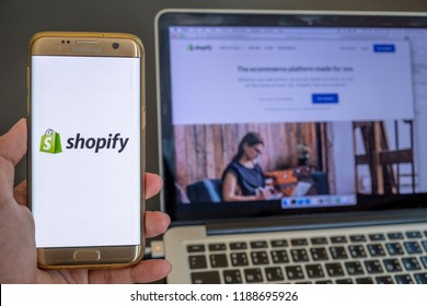 CHIANG MAI,THAILAND - Sep 26,2018: Close up Shopify App on smartphone and Shopify Website in laptop screen with black background.
