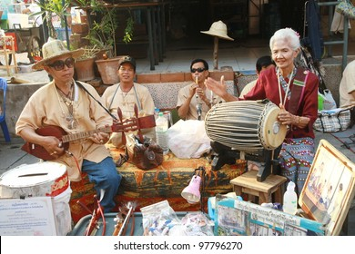 CHIANG MAI,THAILAND-APRIL 12:Unidentified elderly musician perform at walking street market, play on the celebrated Songkran festival,On April 12, 2011 in Chiang Mai, Thailand.