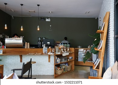 CHIANG MAI,THAILAND-AUGUST 18,2019:Interior design and decoration of 'ABCD a better cup and design' local coffee cafe and bakery pastry shop -decorated with wooden furniture and indoor green plant pot