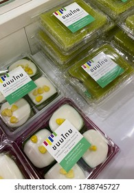 CHIANG MAI,THAILAND-AUGUST 3,2020:Packages of Pandan and coconut pudding custard at 'KANOMWANN KHUN YAI' local Thai dessert store