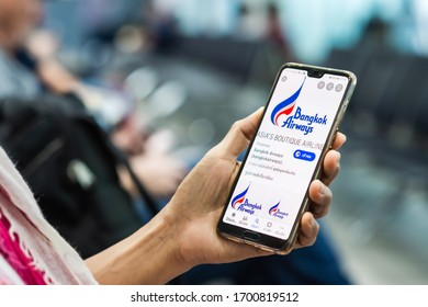 CHIANG MAI,THAILAND-DECEMBER 6,2019:  Traveler check flight details of Bangkok Airways application from smartphone at Chiang Mai international airport  on December 6,2019 in Mandalay Myanmar
