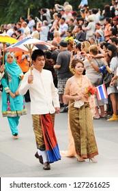 CHIANG MAI,THAILAND-FEB.2 : 37th Anniversary Chiang Mai Flower Festival, Unidentified man and woman in parade annual Chiang Mai flower festival. on Feb.2, 2013 in Chiang Mai,Thailand.