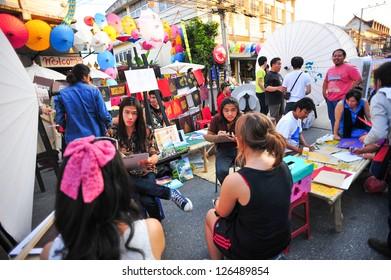CHIANG MAI,THAILAND-JAN.19 : 30th anniversary Bosang umbrella festival,unidentified artist preparing area to display art Umbrella festival at San Kamphaeng. on Jan.19, 2013 in Chiang Mai,Thailand