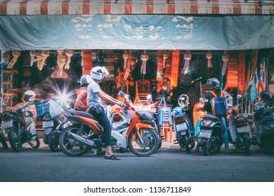 Chiang Mai,Thailand-November 4, 2017:Motorcyclists On the road to shop at Warorot Market, many motorcycle market parked in front of the shop.