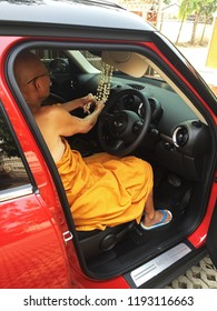 CHIANG MAI,THAILAND-OCTOBER 1,2018:Monk anointing a new car for luck and blessing