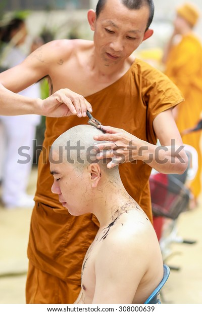 CHIANG RAI ,THAILAND-?July 18 : Monk will be monk cut hair for be Newly ordained in July ?18, ?2015