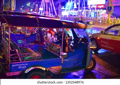 Chiang Rai - MARCH 17: Tuk - tuk on main street at night on MARCH 17, 2018 in Chiang Rai.